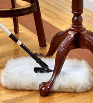 a soft, lambswool floor mop dusting under a Queen Anne style side table
